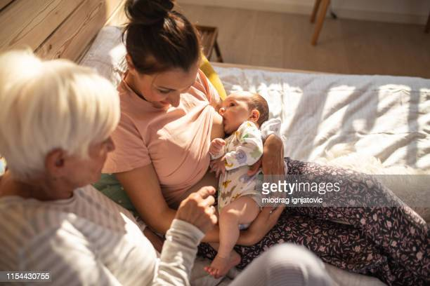 breastfeeding time from above - adult breastfeeding stock pictures, royalty-free photos & images