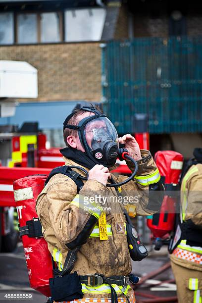 Breathing apparatus and fireman at fire scene in UK