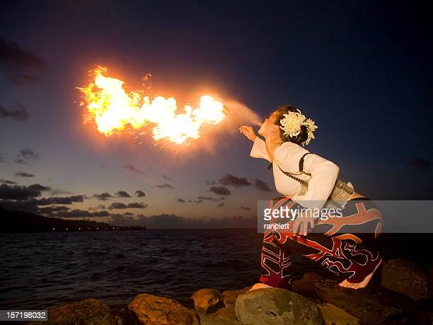 breathing fire - waimea bay hawaii stock photos and pictures