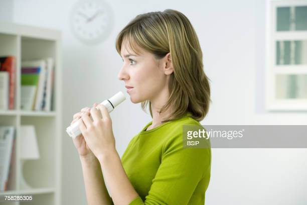 breathing,spirometry in a woman - copd stock photos and pictures