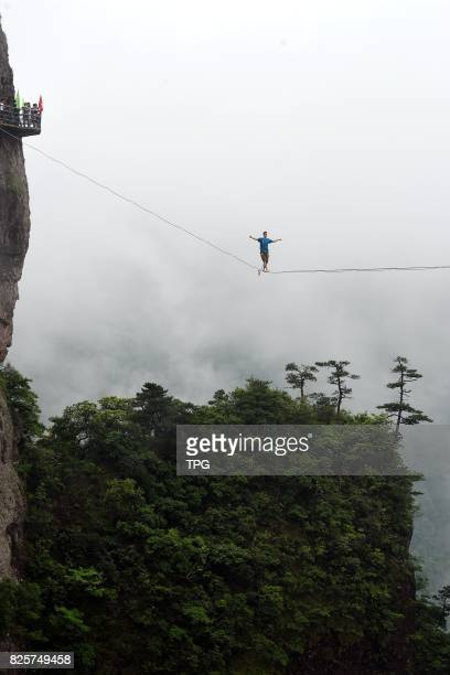 A breathtaking slacklining competition is held in Shenxianju scenic spot in Taizhou City east Chinas Zhejiang Province July 16 2017 More than 30...