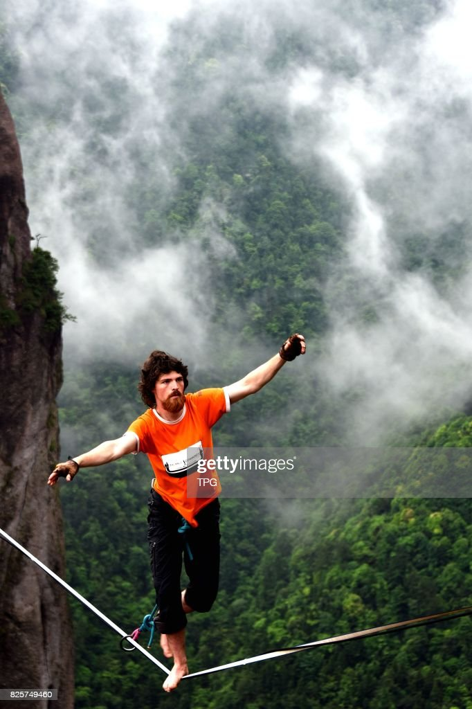 A breath-taking slacklining competition is held in Shenxianju scenic spot in Taizhou City, east Chinas Zhejiang Province, July 16, 2017. More than 30 slacklining masters from all over the world showed off their turns and bounces in the sky. The 18-year-old competitor from Canada Antony won the title of slacklining champion.