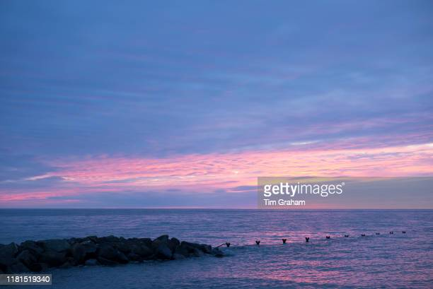 Breathtaking spectacular pastel colours of setting sun above the Atlantic Ocean in Wales United Kingdom