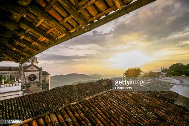 a breathtaking sunset over the rooftops of cuetzalan in eastern mexico - puebla state stock pictures, royalty-free photos & images