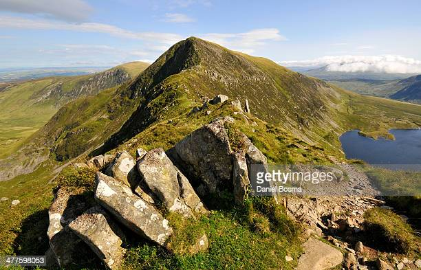 CONTENT] Breathtaking views of green mountains and rocks during a classic hillwalk in Snowdonia close to the Carnedd Llewelyn the second highest...