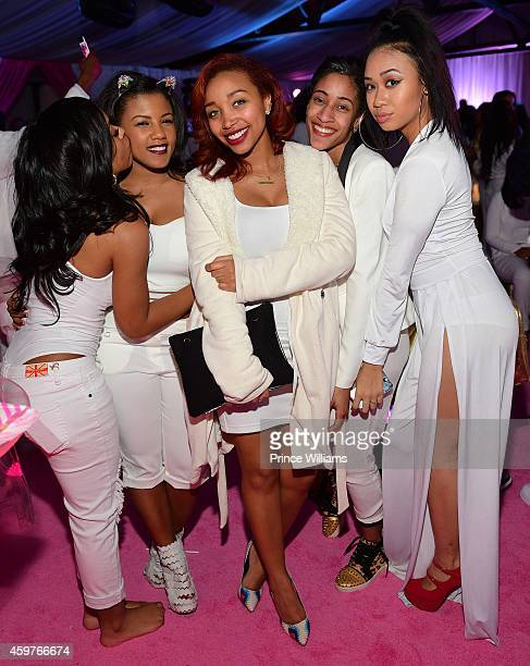 Breaunna Womack and Zonnique Pullins attend Reginae's All White Sweet 16 birthday party at Summerour Studio on November 29 2014 in Atlanta Georgia