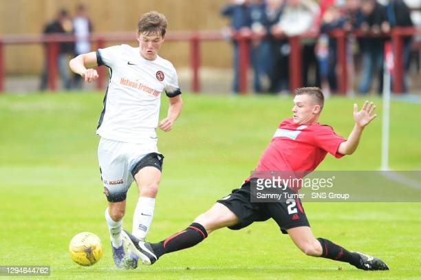 Dundee United's Blair Spittal and Brechin's Chris O'Neil