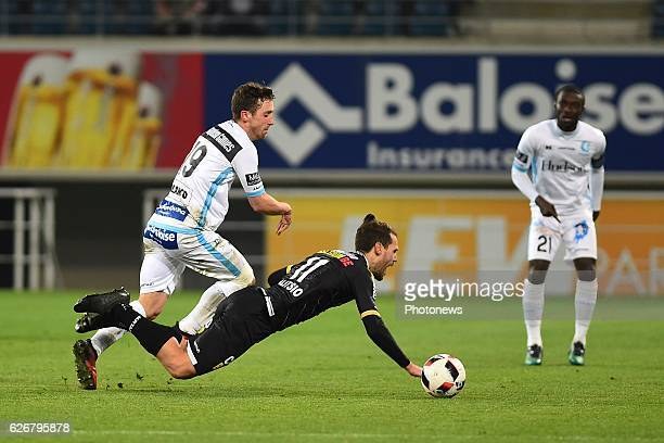 Brecht Dejaegere midfielder of KAA Gent and Giorgos Galitsios of sporting lokeren during the Croky Cup match between KAA Gent and KSC LOKEREN in the...