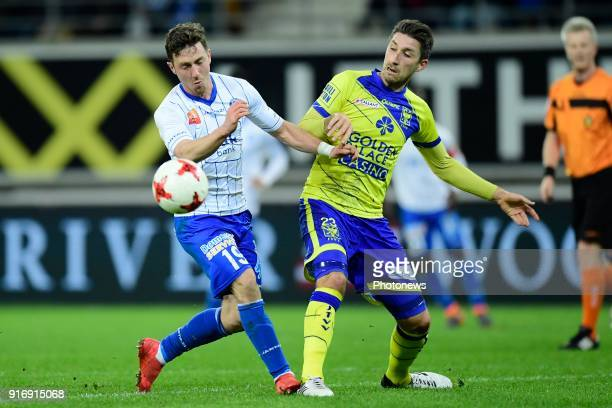 Brecht Dejaegere midfielder of KAA Gent is challenged by Sasha Kotysch defender of STVV during the Jupiler Pro League match between KAA Gent and Sint...