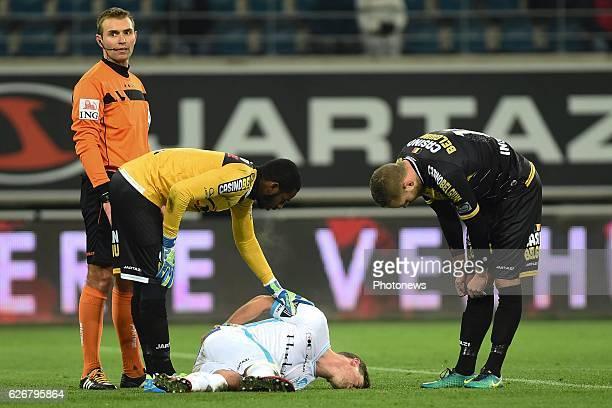 Brecht Dejaegere midfielder of KAA Gent is injured Copa Barry Boubacar goalkeeper of sporting lokeren is looking after him during the Croky Cup match...