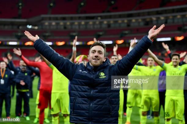 Brecht Dejaegere of Gent leada a team celebration after the UEFA Europa League Round of 32 second leg match between Tottenham Hotspur and KAA Gent at...