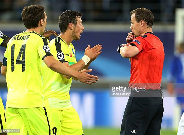 Brecht Dejaegere of KAA Gent receives a red card from referee Williams Collum of Scotland during the UEFA Champions League match between K.A.A. Ghent...