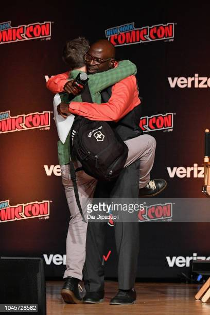 Breckin Meyer and Gary Anthony Williams embrace onstage at the Sony Crackle Presents SuperMansion panel during New York Comic Con 2018 at Jacob K...
