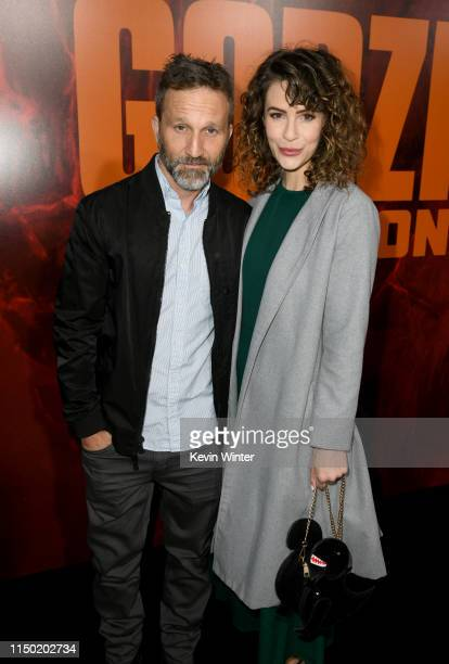 Breckin Meyer and Linsey Godfrey attend the premiere of Warner Bros Pictures and Legendary Pictures' Godzilla King Of The Monsters at TCL Chinese...