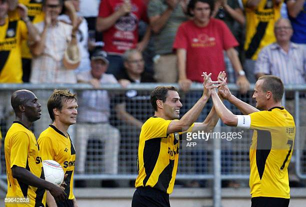 NAC Breda's forward Anthony Lurling celebrates with his teammate midfielder Edwin de Graaf after scoring his team second goal during the 3rd round...