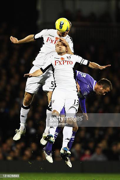 Brede Hangeland and Danny Murphy of Fulham challenge for the ball with Rafael Van Der Vaart of Tottenham Hotspur during the Barclays Premier League...