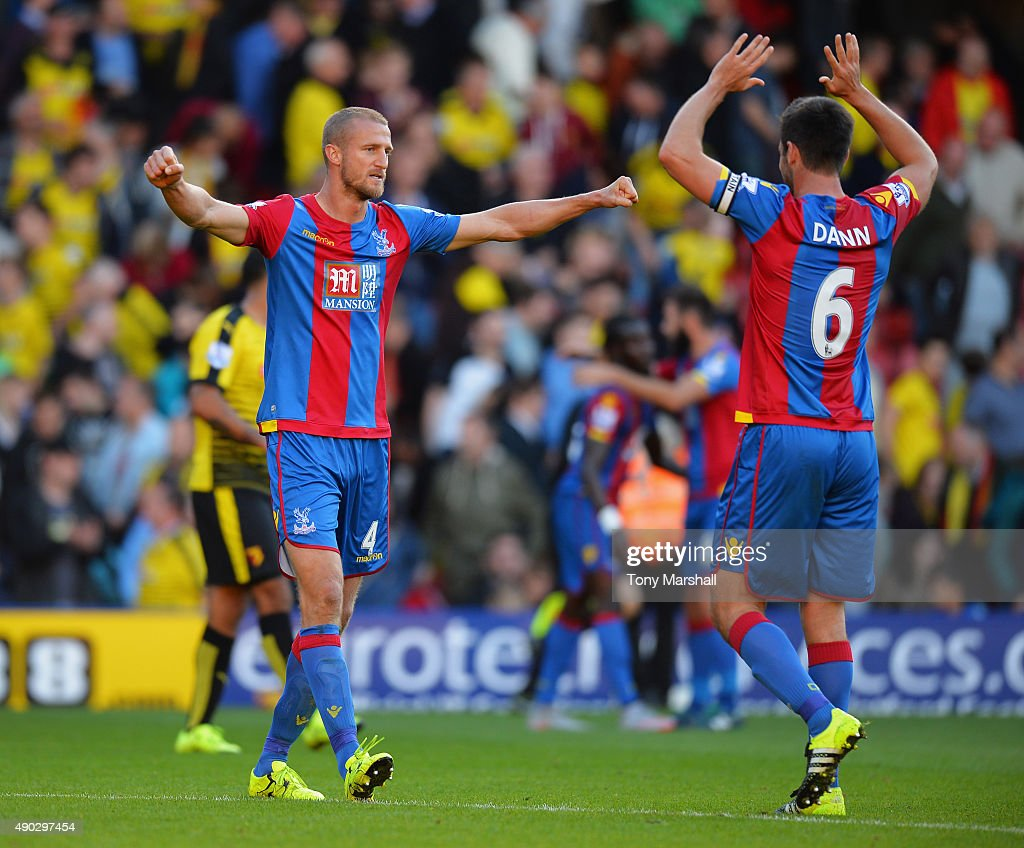 Brede Hangeland and Scott Dann of Crystal Palace (6) celebrate victory after the Barclays Premier League match between Watford and Crystal Palace at Vicarage Road on September 27, 2015 in Watford, United Kingdom.