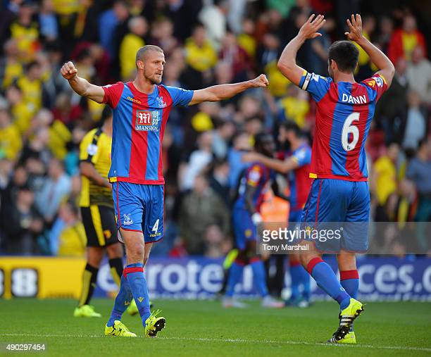 Brede Hangeland and Scott Dann of Crystal Palace celebrate victory after the Barclays Premier League match between Watford and Crystal Palace at...