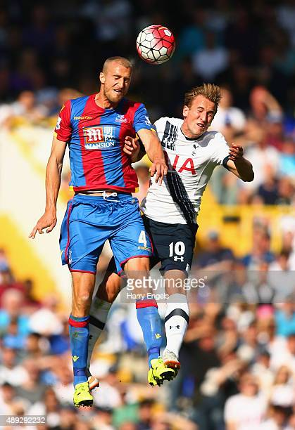 Brede Hangeland of Crystal Palace and Harry Kane of Tottenham Hotspur go up for the header during the Barclays Premier League match between Tottenham...