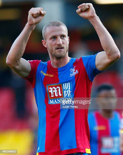 Brede Hangeland of Crystal Palace celebrate victory after the Barclays Premier League match between Watford and Crystal Palace at Vicarage Road on...