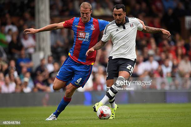 Brede Hangeland of Crystal Palace challenges Hugo Rodallega of Fulham during a Pre Season Friendly between Fulham and Crystal Palace at Craven...