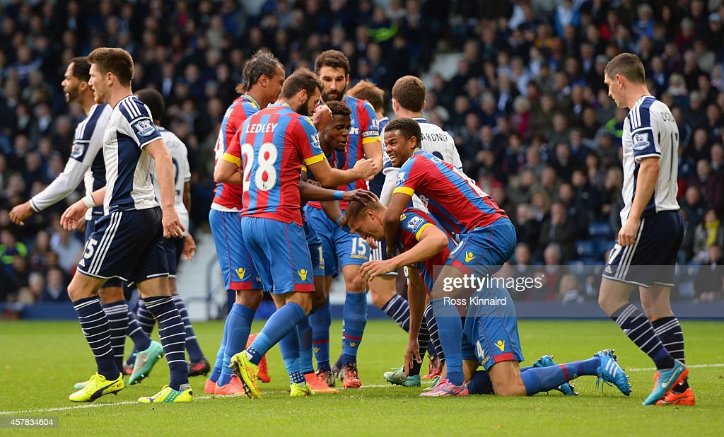 Brede Hangeland of Crystal Palace is mobbed by team mates after scoring the opening goal during the Barclays Premier League match between West Bromwich Albion and Crystal Palace at The Hawthorns on October 25, 2014 in West Bromwich, England.