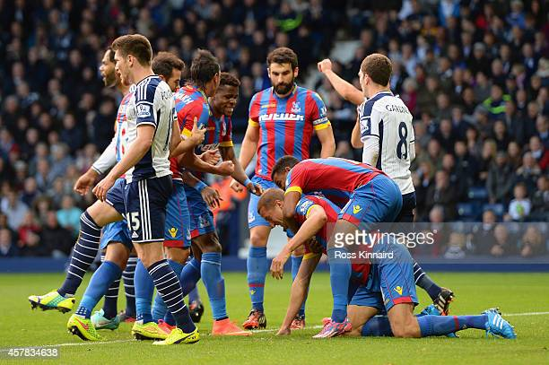 Brede Hangeland of Crystal Palace is mobbed by team mates after scoring the opening goal during the Barclays Premier League match between West...