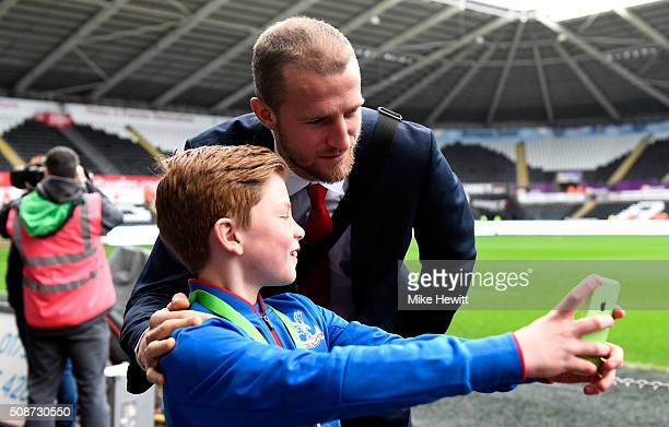 Brede Hangeland of Crystal Palace poses for photographs for a young Crystal Palace supporter prior to the Barclays Premier League match between...