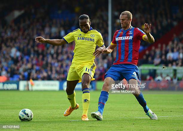 Brede Hangeland of Crystal Palace tackles Didier Drogba of Chelsea during the Barclays Premier League match between Crystal Palace and Chelsea at...