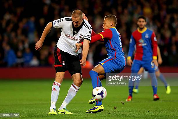 Brede Hangeland of Fulham and Dwight Gayle of Crystal Palace compete for the ball during the Barclays Premier League match between Crystal Palace and...