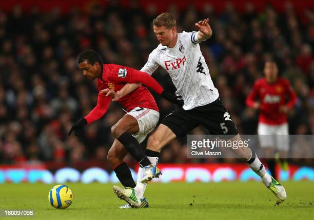 Brede Hangeland of Fulham challenges Nani of Manchester United during the FA Cup with Budweiser Fourth Round match between Manchester United and...