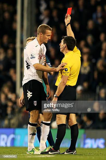 Brede Hangeland of Fulham is shown a straight red card by Referee Lee Probert following a dangerous tackle during the Barclays Premier League match...