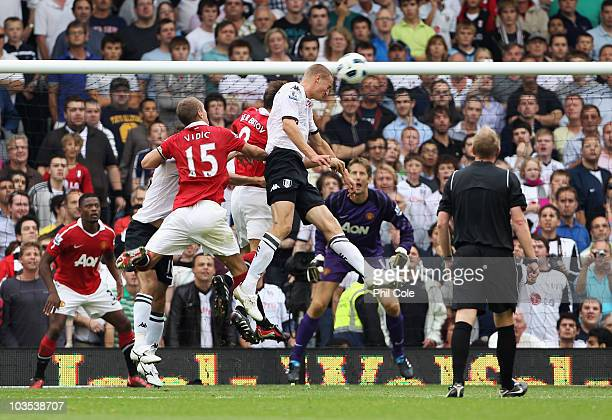Brede Hangeland of Fulham scores their second goal with a header during the Barclays Premier League match between Fulham and Manchester United at...