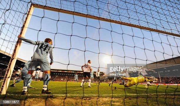 Brede Hangeland of Fulham scores their third goal during the FA Cup sponsored by EON 4th Round match between Fulham and Tottenham Hotspur at Craven...