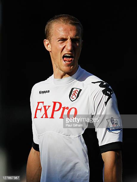 Brede Hangeland of Fulham shouts during the Barclays Premier League match between Fulham and Queens Park Rangers at Craven Cottage on October 2 2011...
