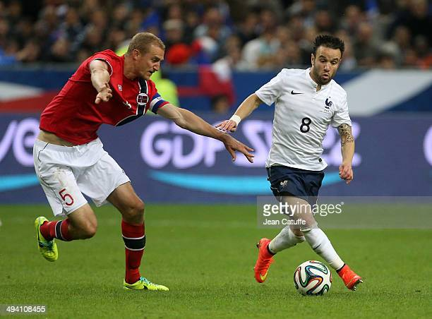 Brede Hangeland of Norway and Mathieu Valbuena of France in action during the international friendly match between France and Norway at Stade de...