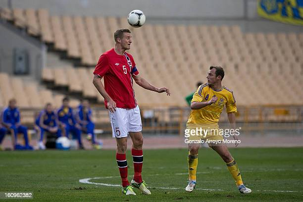 Brede Hangeland of Norway controls the ball as Oleh Husyev of Ukraine looks on during the international friendly football match between Norway and...