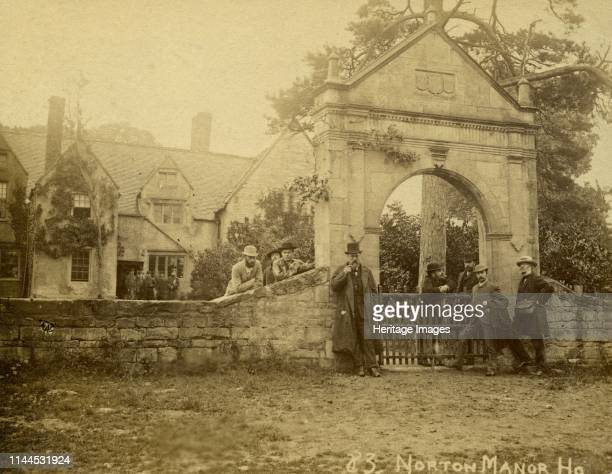 Bredon's Norton Manor Bredon Wychavon Worcestershire 1880s A group of men standing in front of the stone gateway of the manor house with a further...