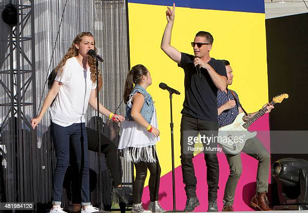 Bree Bogucki Madison Tevlin and Marc Roberge of OAR open the 2015 Los Angeles Special Olympics World Games by performing the CocaCola Unified song...