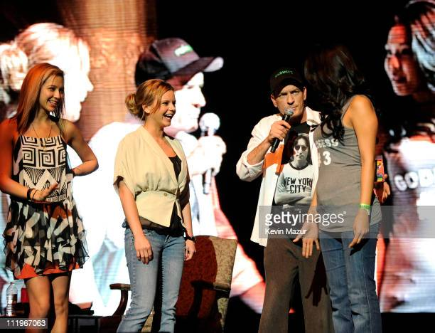 Bree Olson and Natalie Kenly stand on stage during Charlie Sheen's Violent Torpedo of Truth/Defeat Is Not An Option tour at Radio City Music Hall on...