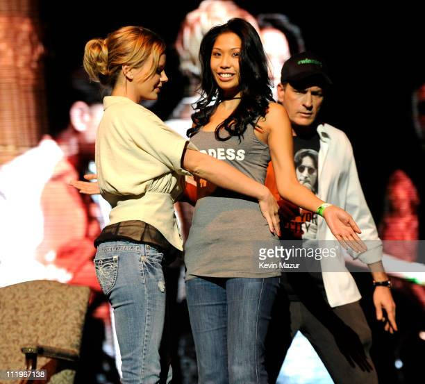 Bree Olson stands on stage during Charlie Sheen's Violent Torpedo of Truth/Defeat Is Not An Option tour at Radio City Music Hall on April 10 2011 in...