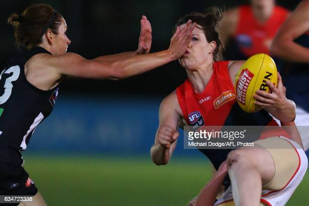 Bree White of the Magpies hits Elise O'Dea of the Demons in the face during the round two AFL Women's match between the Collingwood Magpies and the...