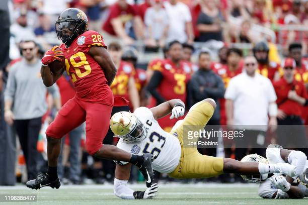 Breece Hall of the Iowa State Cyclones runs with the ball after breaking a tackle against Khalid Kareem of the Notre Dame Fighting Irish in the first...