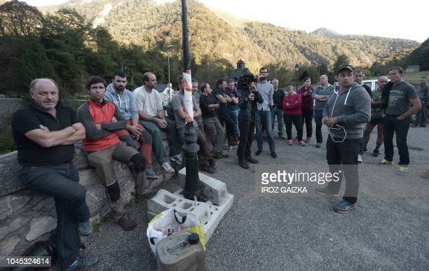 Breeders gather on October 3 2018 in Sarrance in the French Pyrenees as they block the Asp valley access to protest against introduction of two bears...