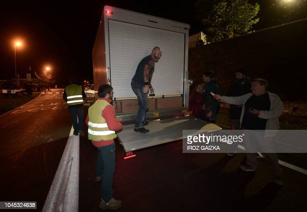 Breeders inspect a vehicle on October 3 2018 in Sarrance in the French Pyrenees as they block the Asp valley access to protest against introduction...