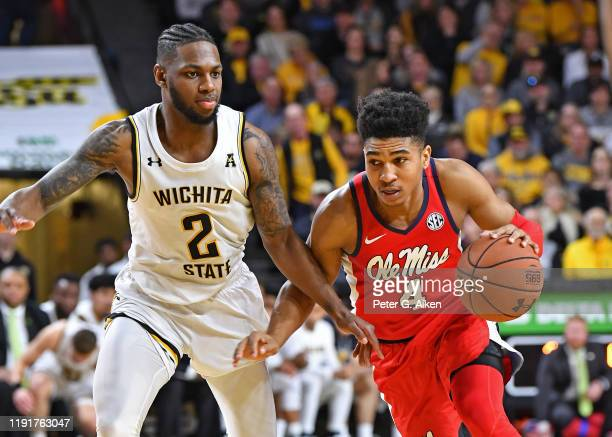 Breein Tyree of the Mississippi Rebels drives up court against Jamarius Burton of the Wichita State Shockers during the second half on January 4 2020...