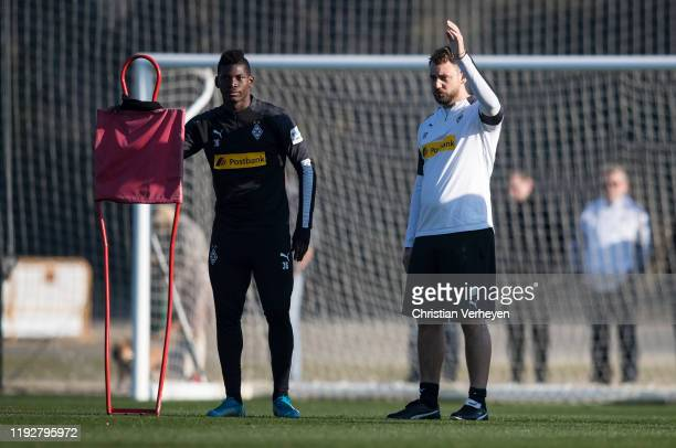 Breel Embolo and Assistant Coach Rene Maric of Borussia Moenchengladbach are seen during the Borussia Moenchengladbach Training Camp on January 09...