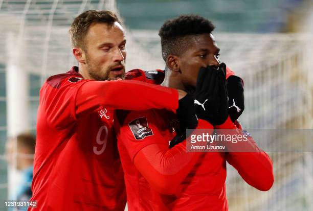 Breel Embolo and Haris Seferovic of Switzerland celebrate their first goal during the FIFA World Cup 2022 Qatar qualifying match between Bulgaria and...
