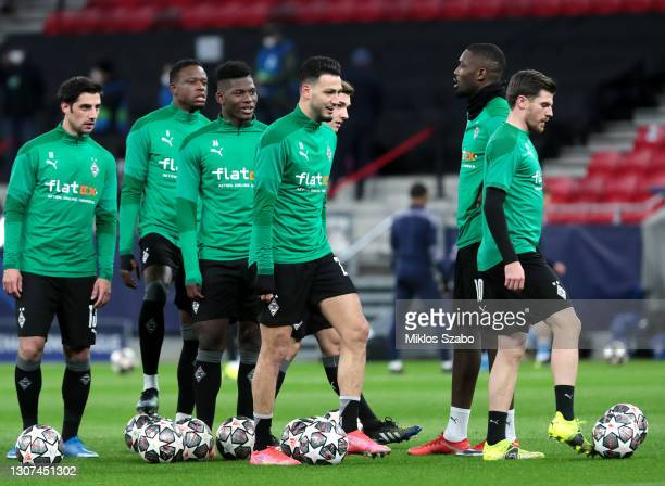 Breel Embolo and Ramy Bensebaini of Borussia Moenchengladbach warm up prior to the UEFA Champions League Round of 16 match between Manchester City...