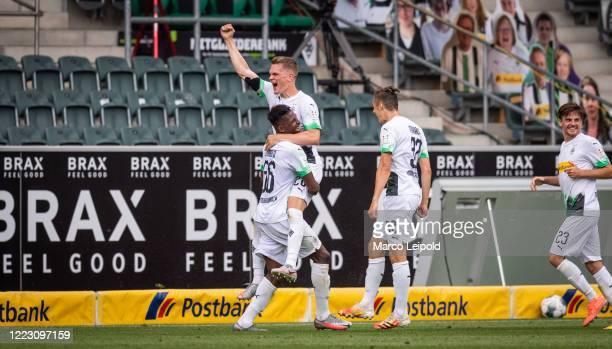 Breel Embolo Matthias Ginter Florian Neuhaus and Jonas Hofmann of Borussia Moenchengladbach celebrate after scoring the 20 during the Bundesliga...